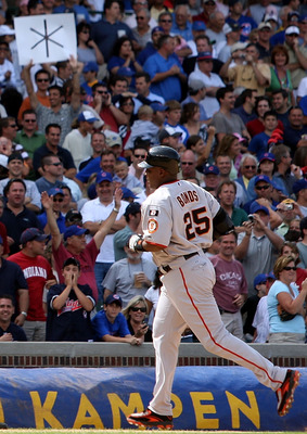 CHICAGO - JULY 19:  Barry Bonds #25 of the San Francisco Giants rounds third base and heads home as a fan holds up a sign with an '*' on it after hitting a 3-run home run, the 753 of his career, in the top of the seventh inning against Will Ohman #13 of t