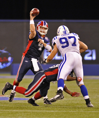 TORONTO - AUGUST 19:  Brian Brohm #4 of the Buffalo Bills passes over John Chick #97 of the Indianapolis Colts during game action August 19, 2010 at the Rogers Centre in Toronto, Ontario, Canada. (Photo by Brad White/Getty Images)