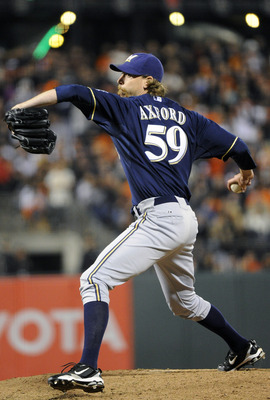 SAN FRANCISCO, CA - JULY 22: John Axford #59 of the Milwaukee Brewers pitches against the San Francisco Giants in the ninth inning during an MLB baseball game at AT&amp;T Park July 22, 2011 in San Francisco, California. The Brewers won the game 4-2. (Photo by