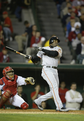 ANAHEIM, CA - OCTOBER 26:  Barry Bonds #25 of the San Francisco Giants hits a home run in the sixth inning giving the Giants a 4-0 lead in game six of the World Series against the Anaheim Angels on October 26, 2002 at Edison Field in Anaheim, California.