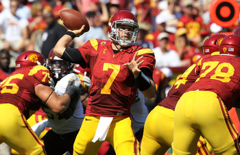 LOS ANGELES, CA - SEPTEMBER 03:  Quarterback Matt Barkley #7 of the USC Trojans throws a pass against the Minnesota Golden Gophers at the Los Angeles Memorial Coliseum on September 3, 2011 in Los Angeles, California. USC won 19-17.  (Photo by Stephen Dunn