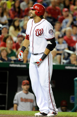 WASHINGTON, DC - AUGUST 23:  Michael Morse #38 of the Washington Nationals reacts after being hit by a pitch during the game against the Arizona Diamondbacks at Nationals Park on August 23, 2011 in Washington, DC.  (Photo by Greg Fiume/Getty Images)