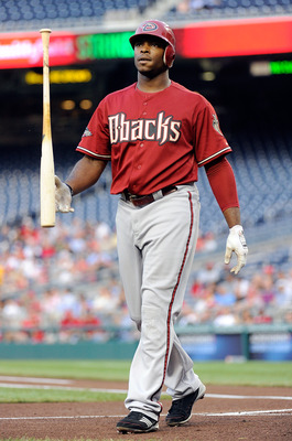 WASHINGTON, DC - AUGUST 24:  Justin Upton #10 of the Arizona Diamondbacks flips his bat after striking out against the Washington Nationals at Nationals Park on August 24, 2011 in Washington, DC.  (Photo by Greg Fiume/Getty Images)