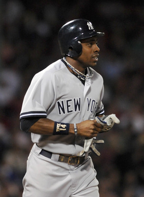 BOSTON, MA - SEPTEMBER 1: Curtis Granderson #14 of the New York Yankees jogs to first in the sixth inning against the Boston Red Sox at Fenway Park on September 1, 2011 in Boston, Massachusetts. The Yankees won the game 4-2. (Photo by Darren McCollester/G