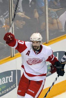 SAN JOSE, CA - MAY 12:  Pavel Datsyuk #13 of the Detroit Red Wings celebrates after scoring a goal in the third period against the San Jose Sharks in Game Seven of the Western Conference Semifinals  during the 2011 NHL Stanley Cup Playoffs at the HP Pavil