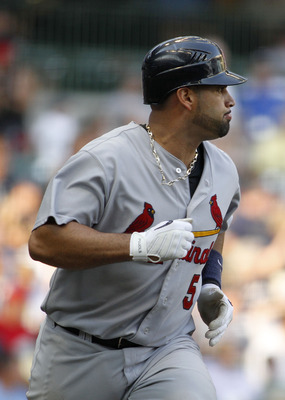 MILWAUKEE, WI - SEPTEMBER1:  Albert Pujols #5 of the St Louis Cardinals runs after hitting a single during their game against the Milwaukee Brewers at Miller Park on September 1, 2011 in Milwaukee, Wisconsin. The Cardinals beat the Brewers 8-4.  (Photo by