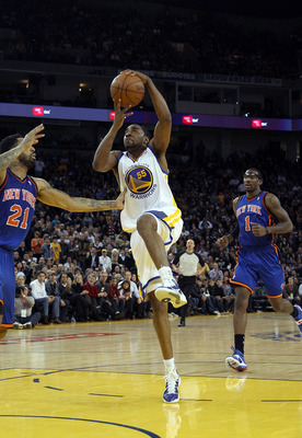 OAKLAND, CA - NOVEMBER 19:  Reggie Williams #55  of the Golden State Warriors in action against the New York Knicks at Oracle Arena on November 19, 2010 in Oakland, California. NOTE TO USER: User expressly acknowledges and agrees that, by downloading and