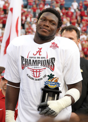 ORLANDO, FL - JANUARY 01:  Courtney Upshaw #41 of the Alabama Crimson Tide accepts the MVP award after winning the Capitol One Bowl against the Michigan State Spartans at the Florida Citrus Bowl on January 1, 2011 in Orlando, Florida.  (Photo by Mike Ehrm