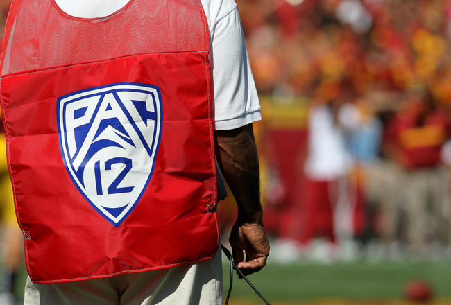 LOS ANGELES - SEPTEMBER 3:   A sideline official wears a vest with the logo for the Pac 12 conference during the game between the Minnesota Golden Gophers and the USC Trojans at the Los Angeles Memorial Coliseum on September 3, 2011 in Los Angeles, Califo