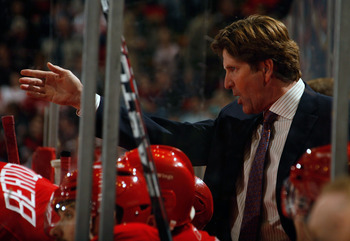 DETROIT, MI - NOVEMBER 21:  Head Coach Mike Babcock of the Detroit Red Wings gives direction to his team as they face the Calgary Flames during their NHL game at Joe Louis Arena on November 21, 2010 in Detroit, Michigan.(Photo by Dave Sandford/Getty Image