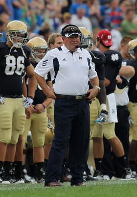 SOUTH BEND, IN - SEPTEMBER 03:  Head coach Brian Kelly of the Notre Dame Fighting Irish watches as his team takes on the University of South Florida Bulls at Notre Dame Stadium on September 3, 2011 in South Bend, Indiana.  (Photo by Jonathan Daniel/Getty