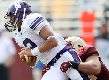 CHESTNUT HILL, MA - SEPTEMBER 03:  Kain Colter #2 of the Northwestern Wildcats scrambes as Max Holloway #56 of the Boston College Eagles pressures on September 3, 2011 at Alumni Stadium in Chestnut Hill, Massachusetts.The Northwestern Wildcats defeated th