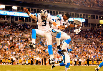 CHARLOTTE, NC - SEPTEMBER 01:  Teammates Derek Anderson #3 and Cam Newton #1 of the Carolina Panthers celebrate after Anderson throws a touchdown against the Pittsburgh Steelers during their preseason game at Bank of America Stadium on September 1, 2011 i