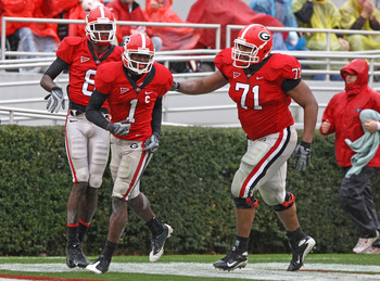 ATHENS, GA - NOVEMBER 29:  Wide receiver A.J. Green #8 (L) and offensive lineman Cordy Glenn #71 (R) of the Georgia Bulldogs congratulate Mohamed Massaquoi #1 after one of his three first half touchdowns during the game against the Georgia Tech Yellow Jac
