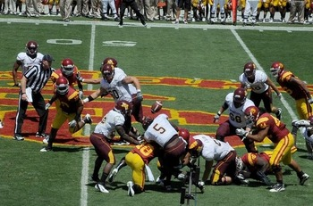 Minnesota fumbles after hard hit but recovers the ball (Photo courtesy of USCTrojans.com by John SooHoo)