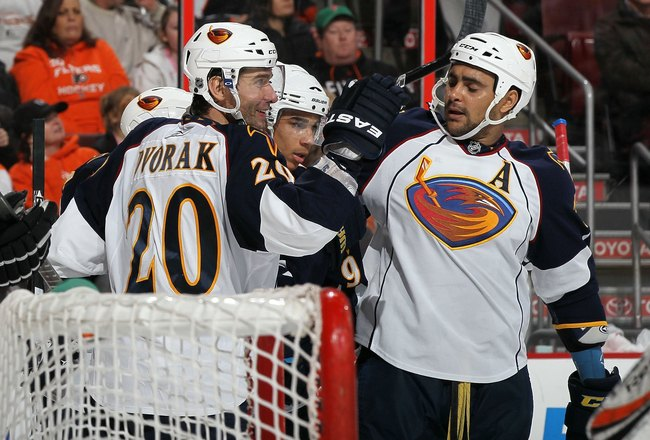 PHILADELPHIA, PA - MARCH 12:  Evander Kane #9 of the Atlanta Thrashers celebrates his goal against the Philadelphia Flyers with teammates Radek Dvorak #20 and Dustin Byfuglien #33 on March 12, 2011 at Wells Fargo Center in Philadelphia, Pennsylvania. The