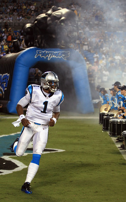CHARLOTTE, NC - SEPTEMBER 01:  Cam Newton #1 of the Carolina Panthers is introduced before their preseason game against the Pittsburgh Steelers at Bank of America Stadium on September 1, 2011 in Charlotte, North Carolina.  (Photo by Streeter Lecka/Getty I