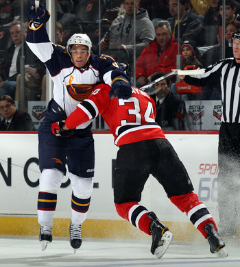 NEWARK, NJ - MARCH 15: Mark Fayne #34 of the New Jersey Devils holds up Evander Kane #9 of the Atlanta Thrashers at the Prudential Center on March 15, 2011 in Newark, New Jersey.  (Photo by Bruce Bennett/Getty Images)