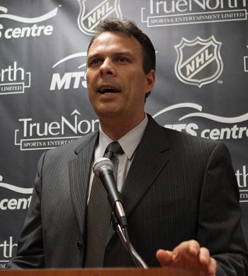 MINNEAPOLIS, MN - JUNE 24:  General Manager Kevin Cheveldayoff of the Winnipeg franchise of the National Hockey League introduces Claude Noel as their new head coach at the Westin Hotel on June 23, 2011 in Minneapolis, Minnesota.  (Photo by Bruce Bennett/