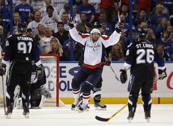 TAMPA, FL - MAY 03: Eric Fehr #16 of the Washington Capitals celebrates a second period goal by John Carlson #74 (not shown) against the Tampa Bay Lightning in Game Three of the Eastern Conference Semifinals during the 2011 NHL Stanley Cup Playoffs at St