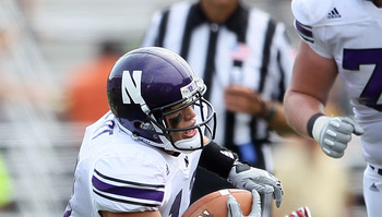 CHESTNUT HILL, MA - SEPTEMBER 03:  Jeremy Ebert #11 of the Northwestern Wildcats carries the ball in the second half against the Boston College Eagles on September 3, 2011 at Alumni Stadium in Chestnut Hill, Massachusetts.The Northwestern Wildcats defeate