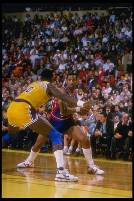 1988-1989:  Adrian Dantley of the Detroit Pistons moves the ball during a game. Mandatory Credit: Jonathan Daniel  /Allsport Mandatory Credit: Jonathan Daniel  /Allsport