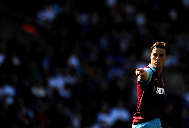 BOLTON, ENGLAND - APRIL 09:  Scott Parker of West Ham United gestures during the Barclays Premier League match between Bolton Wanderers and West Ham United at Reebok Stadium on April 9, 2011 in Bolton, England.  (Photo by Chris Brunskill/Getty Images)