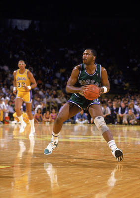 LOS ANGELES - 1988:  Mark Aguirre #24 of the Dallas Mavericks moves the ball during the NBA game against the Los Angeles Lakers at the Great Western Forum in Los Angeles, California in 1988.  (Photo by Rick Stewart/Getty Images)