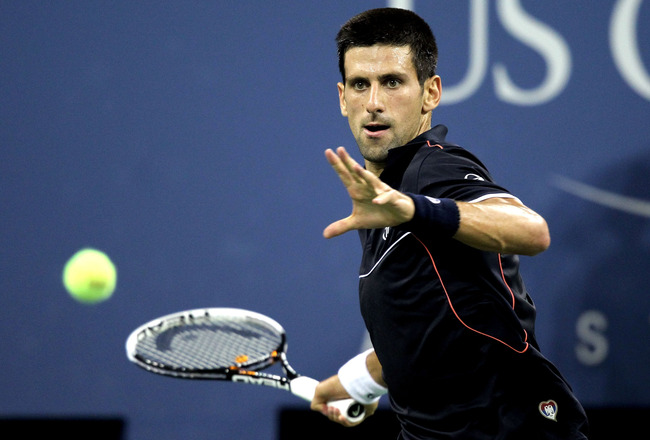 NEW YORK, NY - SEPTEMBER 03:  Novak Djokovic of Serbia returns a shot to Nikolay Davydenko of Russia during Day Six of the 2011 US Open at the USTA Billie Jean King National Tennis Center on September 3, 2011 in the Flushing neighborhood of the Queens bor