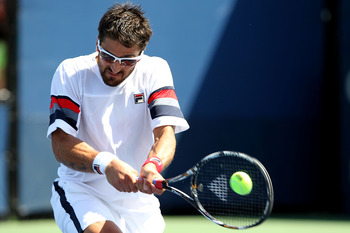 NEW YORK, NY - SEPTEMBER 01:  Janko Tipsarevic of Serbia returns a shot against Philipp Petzschner of Germany during Day Four of the 2011 US Open at the USTA Billie Jean King National Tennis Center on September 1, 2011 in the Flushing neighborhood of the