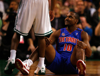 BOSTON - MAY 28:  Lindsey Hunter #10 of the Detroit Pistons looks on from the floor after getting knocked down against the Boston Celtics during Game Five of the Eastern Conference finals during the 2008 NBA Playoffs at TD Banknorth Garden on May 28, 2008