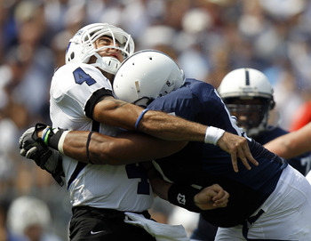 STATE COLLEGE, PA - SEPTEMBER 3:  Jordan Hill #47 of the Penn State Nittany Lions hits Ronnie Fouch #4 of the Indiana State Sycamores during the game on September 3, 2011 at Beaver Stadium in State College, Pennsylvania.  (Photo by Justin K. Aller/Getty I