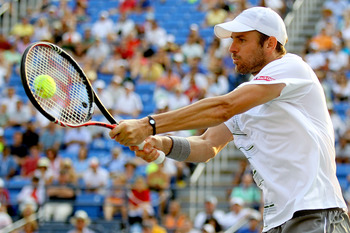 NEW YORK, NY - SEPTEMBER 03:  Mardy Fish of the United States returns a shot against Kevin Anderson of South Africa during Day Six of the 2011 US Open at the USTA Billie Jean King National Tennis Center on September 3, 2011 in the Flushing neighborhood of