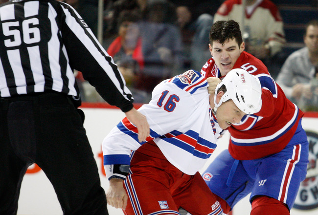MONTREAL, CANADA - FEBRUARY 5:  Alexandre Picard #45 of the Montreal Canadiens and Sean Avery #16 of the New York Rangers fight during the NHL game at the Bell Centre on February 5, 2011 in Montreal, Quebec, Canada.  (Photo by Richard Wolowicz/Getty Image