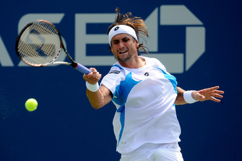NEW YORK, NY - SEPTEMBER 04:  David Ferrer of Spain returns a shot against Florian Mayer of Germany during Day Seven of the 2011 US Open at the USTA Billie Jean King National Tennis Center on September 4, 2011 in the Flushing neighborhood of the Queens bo