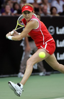 AUCKLAND, NEW ZEALAND - FEBRUARY 01:  Monica Seles stretches out to return the ball during her exhibition match against Martina Navratilova, Tuesday 01, February, 2005, at the ASB Bank Tennis Centre in Auckland, New Zealand. Navratilova won the game in st