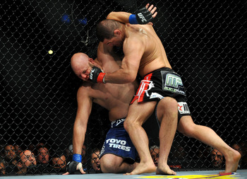 LOS ANGELES, CA - OCTOBER 24:  UFC fighter Cain Velasquez (R) hits UFC fighter Ben Rothwell (L) up against the fence during their Heavyweight bout at UFC 104: Machida vs. Shogun at Staples Center on October 24, 2009 in Los Angeles, California.  (Photo by