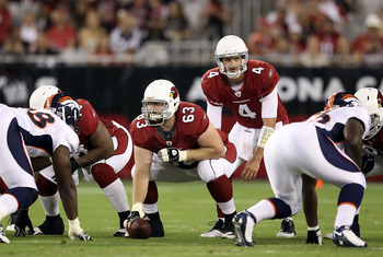 GLENDALE, AZ - SEPTEMBER 01:  Quarterback Kevin Kolb #4 of the Arizona Cardinals prepares to snap the football during the preseason NFL game against the Denver Broncos at the University of Phoenix Stadium on September 1, 2011 in Glendale, Arizona. The Car