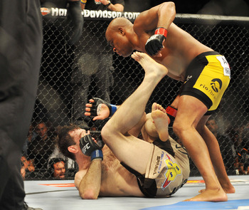 PHILADELPHIA - AUGUST 08:  (Top) Anderson Silva battles  Forrest Griffin during their light heavyweight bout at UFC 101: Declaration at the Wachovia Center on August 8, 2009 in Philadelphia, Pennsylvania.  (Photo by Jon Kopaloff/Getty Images)