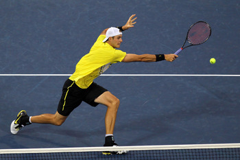 NEW YORK, NY - SEPTEMBER 04:  John Isner of the United States returns a shot against  Alex Bogomolov Jr., of the United States during Day Seven of the 2011 US Open at the USTA Billie Jean King National Tennis Center on September 4, 2011 in the Flushing ne