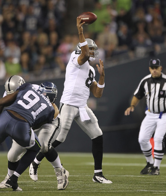 SEATTLE - SEPTEMBER 02:  Quarterback Jason Campbell #8 of the Oakland Raiders passes against the Seattle Seahawks at CenturyLink Field on September 2, 2011 in Seattle, Washington. (Photo by Otto Greule Jr/Getty Images)
