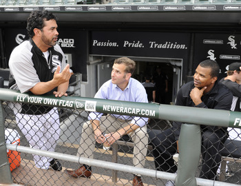 CHICAGO, IL - AUGUST 12: Ozzie Guillen #13 manager of the Chicago White Sox (L), Rick Hahn White Sox assistant general manager (C), and Kenny Williams general manager talk before the game against the Kansas City Royals on August 12, 2011 at U.S. Cellular