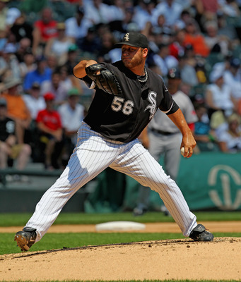 CHICAGO, IL - JULY 31: Starting pitcher Mark Buehrle #56 of the Chicago White Sox delivers the ball against the Boston Red Sox at U.S. Cellular Field on July 31, 2011 in Chicago, Illinois. (Photo by Jonathan Daniel/Getty Images)