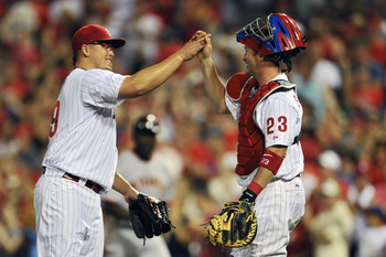 PHILADELPHIA, PA - JULY 26: Starting pitcher Vance Worley #49 of the Philadelphia Phillies high-fives teammate Brian Schneider #23 after pitching a complete game and defeating the San Francisco Giants 7-2 at Citizens Bank Park on July 26, 2011 in Philadel