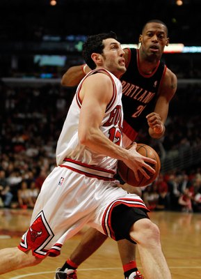 CHICAGO - FEBRUARY 26: Kirk Hinrich #12 of the Chicago Bulls drives to the basket past Marcus Camby #21 of the Portland Trail Blazers at the United Center on February 26, 2010 in Chicago, Illinois. The Bulls defeated the Trail Blazers 115-111 in overtime.