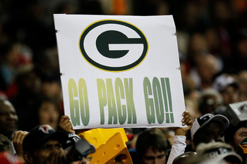 ATLANTA, GA - JANUARY 15:  A fan of the Green Bay Packers holds up a sign which reads 'Go Pack Go!' against the Atlanta Falcons during their 2011 NFC divisional playoff game at Georgia Dome on January 15, 2011 in Atlanta, Georgia. The Packers won 48-21. (