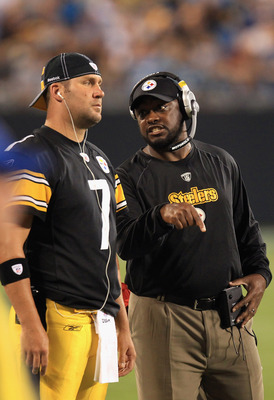 CHARLOTTE, NC - SEPTEMBER 01:  Head coach Mike Tomlin and Ben Roethlisberger #7 of the Pittsburgh Steelers talk on the sidelines during their preseason game against the Carolina Panthers at Bank of America Stadium on September 1, 2011 in Charlotte, North