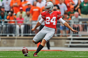 COLUMBUS, OH - SEPTEMBER 11:  Drew Basil #24 of the Ohio State Buckeyes kicks off against the Miami Hurricanes at Ohio Stadium on September 11, 2010 in Columbus, Ohio.  (Photo by Jamie Sabau/Getty Images)