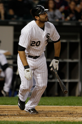 CHICAGO, IL - AUGUST 13: Carlos Quentin #20 of the Chicago White Sox hits against the Kansas City Royals at U.S. Cellular Field on August 13, 2011 in Chicago, Illinois. (Photo by John Gress/Getty Images)