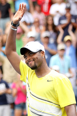 NEW YORK, NY - SEPTEMBER 04:  Donald Young of the United States celebrates after defeating Juan Ignacio Chela of Argentina during Day Seven of the 2011 US Open at the USTA Billie Jean King National Tennis Center on September 4, 2011 in the Flushing neighb
